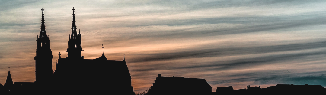 Basel-Muenster-Silhouette-Sonnenuntergang_cropped_farb-bearb3_1080x314